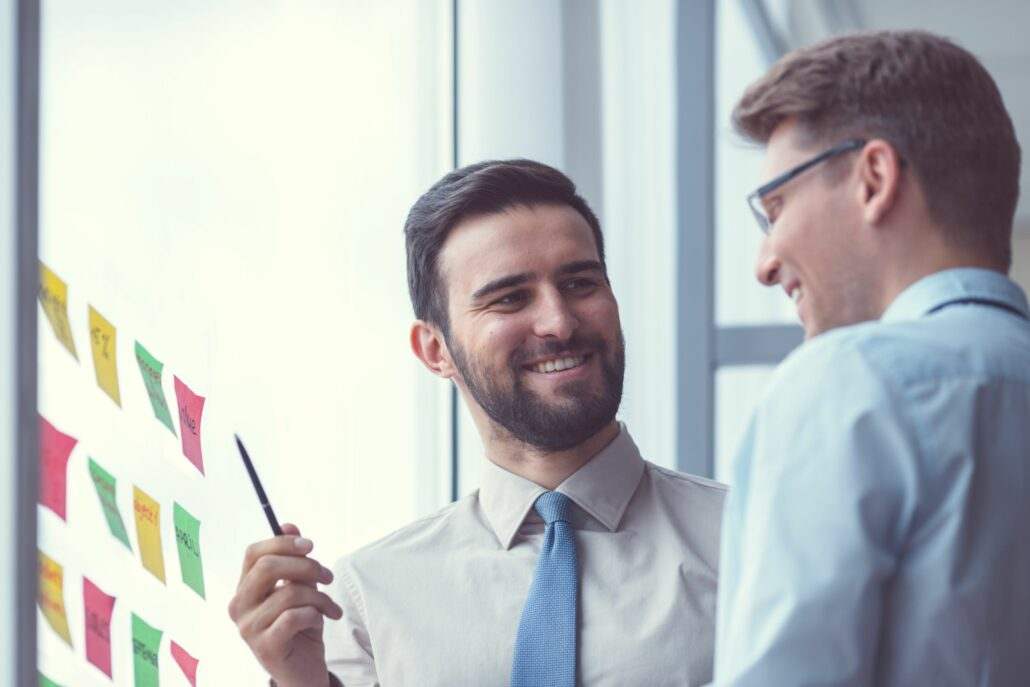 two male office workers talking