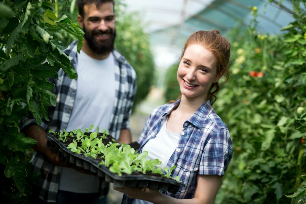 young woman working in a plant nursery