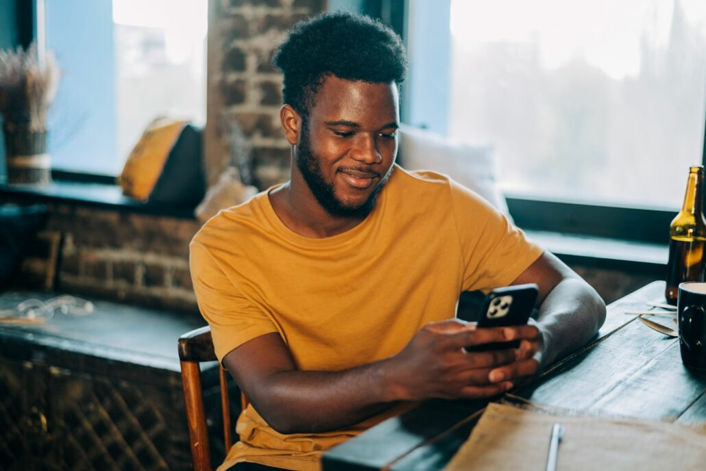 young man on his phone